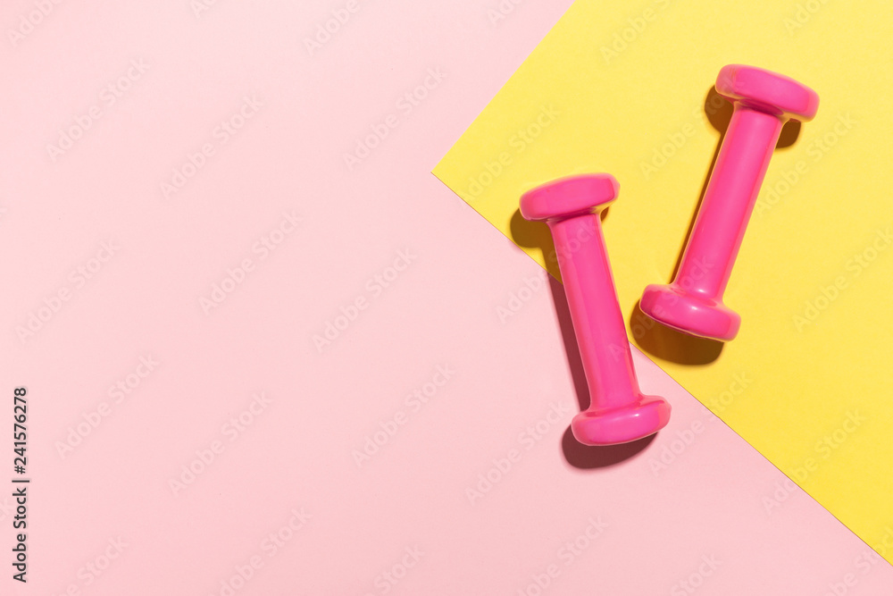 Fototapety, obrazy: Dumbbells flat lay on pink and yellow