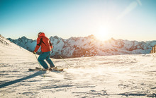 Young Man Skiing In Alps Mountains On Sunny Day