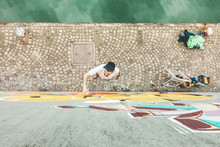 Top View Of Graffiti Artist Painting With Color Spray On The Wall