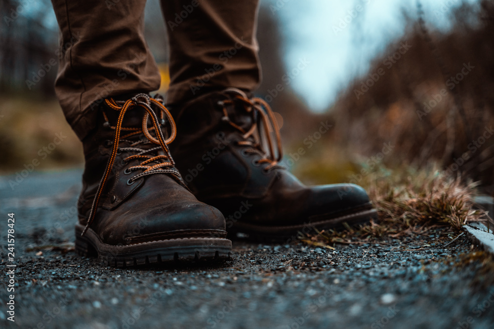 Fototapeta Hiking Boots Standing on Gravel Path in Mountains Wilderness Nature