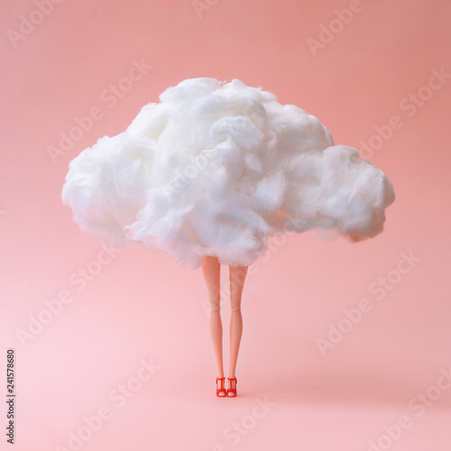 Obraz Girl doll against pastel coral color background. Head in the clouds concept. - fototapety do salonu