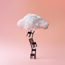 Stacked Chairs With Cloud Against Coral Color Background. Minimal Success Concept Background.