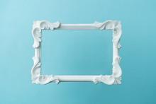 White Vintage Frame On Pastel Blue Background. Minimal Border Composition.