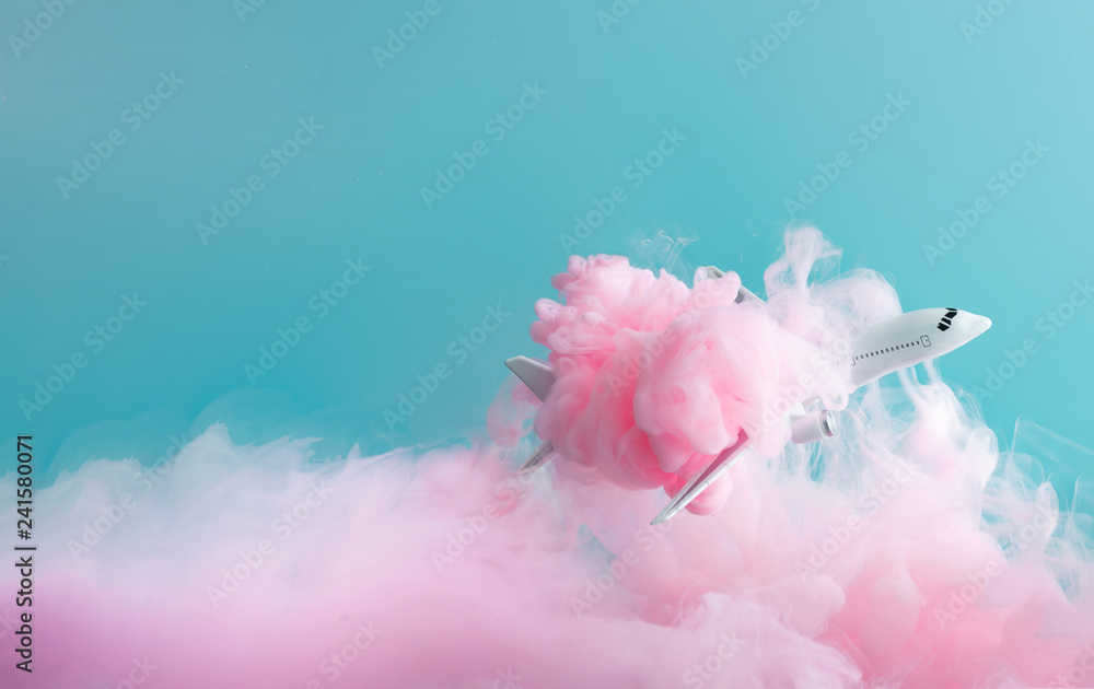 Fototapety, obrazy: Passenger jet airplane flying through pastel pink clouds. Minimal transportation, travel or vacation concept.