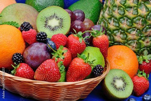 Fotografie, Obraz  Fresh fruits in a basket on wooden table