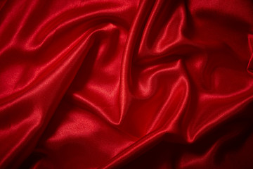 Luxury red satin smooth fabric background for celebration, ceremony, event invitation card or advertising poster