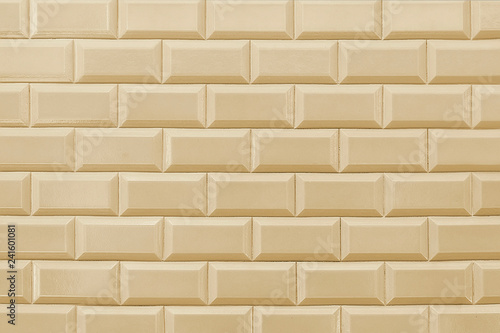 Fotografía  Old beige tile brick wall background texture