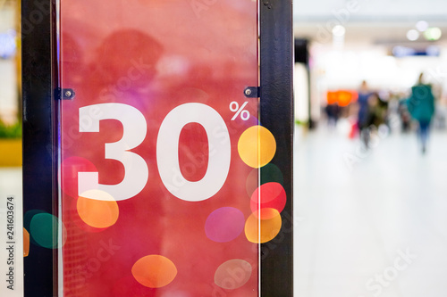 Large Sale 30 off letters on shopping mall wall pillar