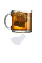 Cup With Tea Bag Against White Background