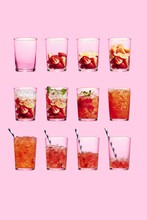 Isolated Zombie Cocktail Drink In Glass Against Pink Background