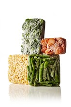 Stack Of Frozen Vegetables On White Background