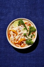 Overhead View Of Thai Coconut Chicken Ramen With Broccoli Served In Bowl