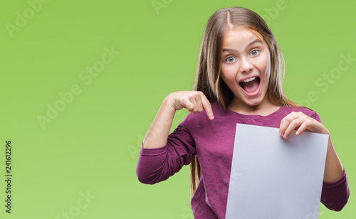 Obraz Young beautiful girl holding blank sheet paper over isolated background with surprise face pointing finger to himself - fototapety do salonu