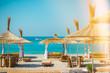 Sunshade umbrellas and deckchairs on the beautiful beach in Himara, Albania.