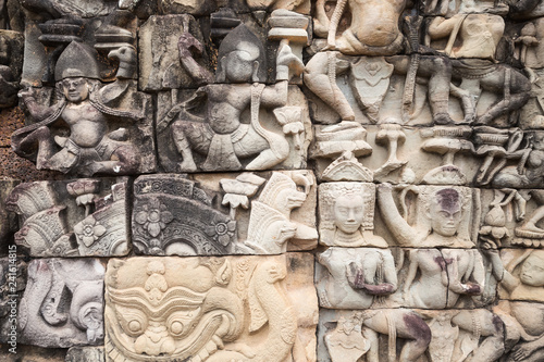 фотография  Ancient ruins and bas relief in Siem Reap Park, Cambodia