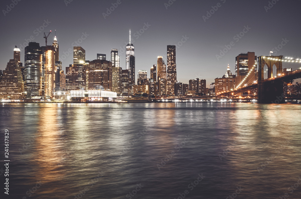 New York City skyline at night, color toned picture, USA.