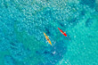 Drone shot of couple kayaking in sea