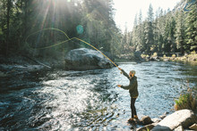 Side View Of Man Fly Fishing A...
