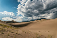 Idyllic View Of Desert Against Cloudy Sky At Great Sand Dunes National Park