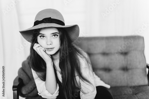 Fotografie, Obraz  Close up portrait of young cheerful positive emotional casual girl in fashionable hat