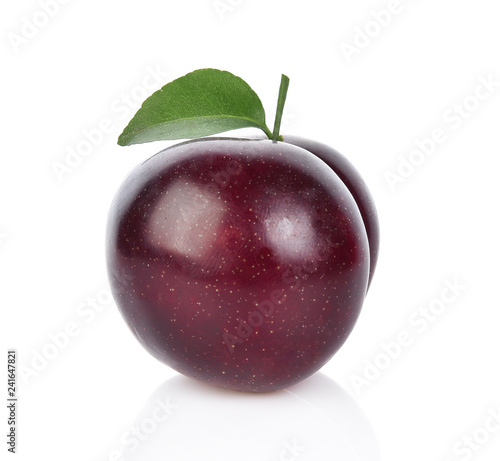 Fototapeta red cherry plum with green leaves isolated on white background