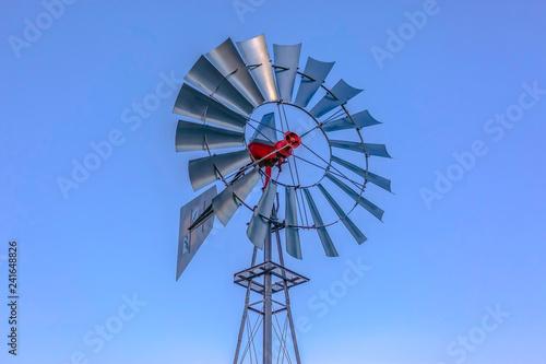 Fotografie, Obraz  Looking up at aluminum windmill sky behind