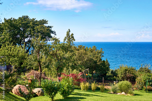 Photo  Big green garden with Baltic Sea in the background