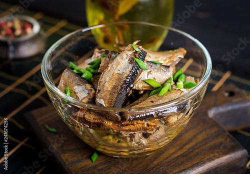 Sprats in a glass bowl. European cuisine