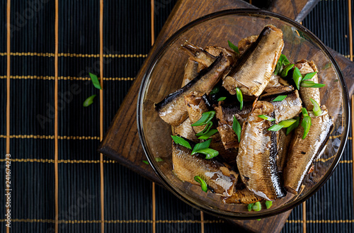 Sprats in a glass bowl. European cuisine. Top view