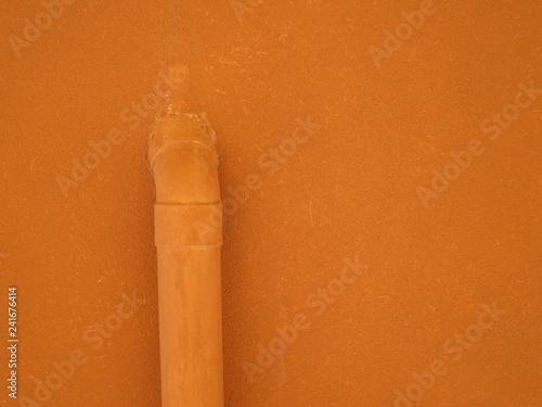 Fotografia, Obraz  orange pastel painted wall with a drainpipe in Gallipoli Italy