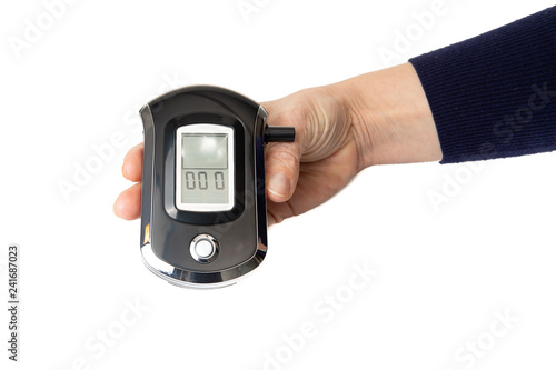 Digital portable Alcohol Breath Tester Breathalyzer Analyzer Detector in hands i Wallpaper Mural
