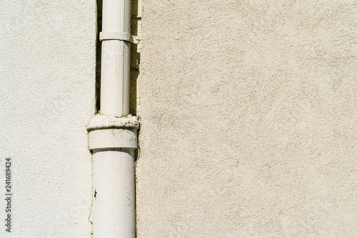 Drainpipe on house wall Canvas Print
