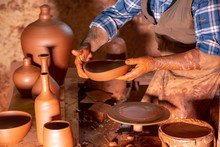 Professional Potter Making Bow...