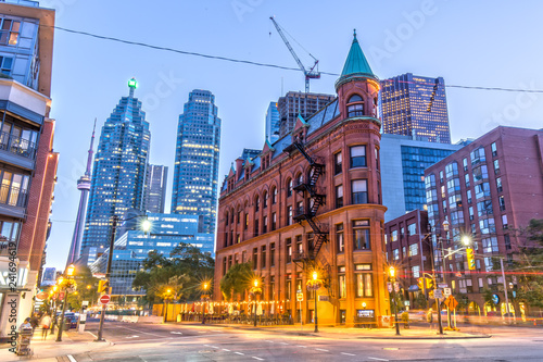 Photo  Gooderham Building in Toronto with CN Tower in the Background
