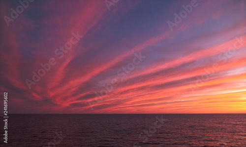 Photo Stands Crimson Sunset Over The Sea, Clear Separation Lines With Saturated Pink Color
