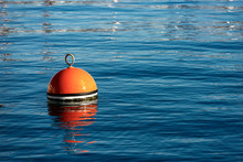 Red And Orange Mooring Buoy In...