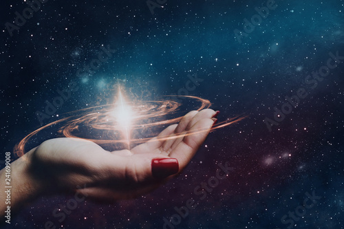 Woman hand hold a new star in infinite space. Mixed media. - 241699008