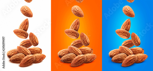 Photo Falling almond nuts isolated on white background