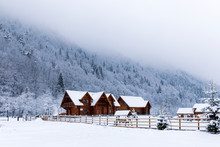 Wooden House In The Mountains During Winter