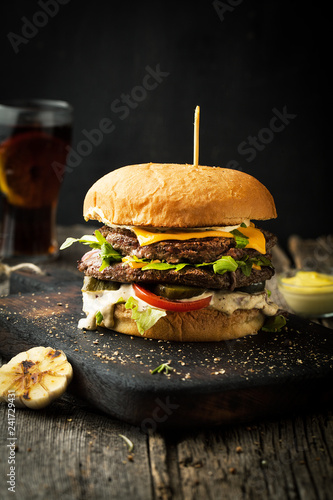 Fototapeta Delicious double cheeseburger with arugula and sauce obraz