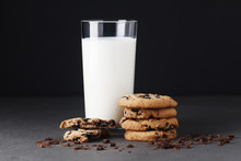 Stack Of Chocolate Chip Cookies And Milk On Black Background. Mockup For Input The Text.