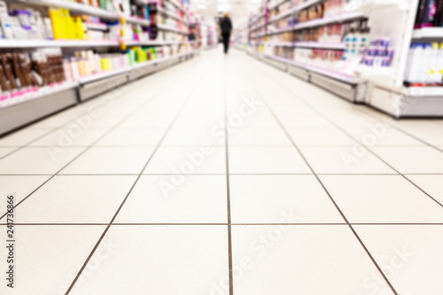 Abstract background blurred photograph of an aisle with shelves in bright modern Wallpaper Mural