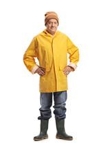 Mature Man In A Yellow Raincoat