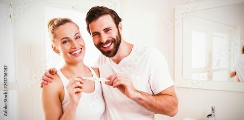 Foto op Canvas Hoogte schaal Portrait of happy couple checking pregnancy test