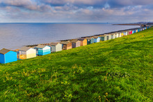 Row Of Beach Huts Along The Co...