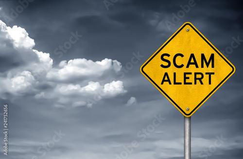 Obraz na plátně  Scam Alert - warning sign