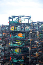 Dungeness Crab Pots Stacked On Dock.