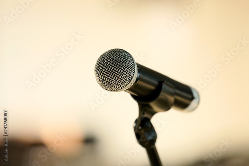 Microphone on abstract blurred hall light - 241768097