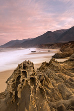 A Pink Sunrise And Interesting Rocks At Garrapata State Park Beach Along The Coast Of Big Sur, CA.
