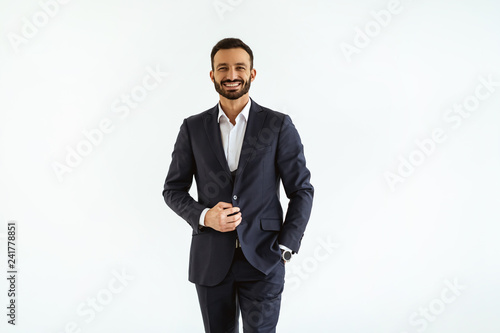 Canvastavla The businessman in a beautiful suit standing on the white background